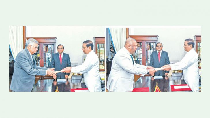 A new Cabinet was sworn in before President Maithripala Sirisena at the Presidential Secretariat yesterday.  Prime Minister Ranil Wickremesinghe being sworn in as Minister of National Polices, Economic Affairs, Resettlement and Rehabilitation, Northern Province Development, Vocational Training and Skills Development and Youth Affairs and Mangala Samaraweera as Minister of Finance and Mass Media. Pictures courtesy President's Media Division. See pages 10 and 11