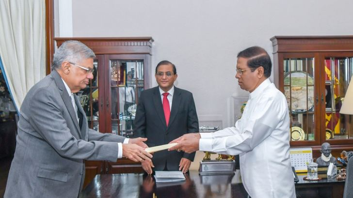 Prime Minister Ranil Wickremesinghe swearing in as Minister of National Polices, Economic Affairs, Resettlement and Rehabilitation, Northern Province Development, Vocational Training and Skills Development and Youth Affairs before President Maithripala Sirisena at the Presidential Secretariat on Thursday. Picture courtesy President's Media Division