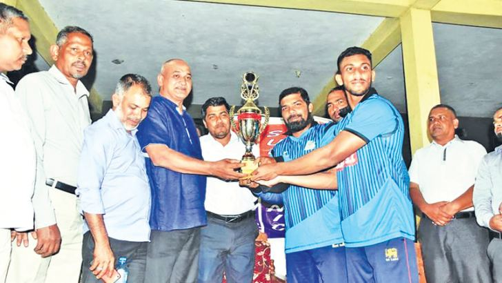 The skipper of Addalaichenai Sober Sports Club receiving the trophy from Divisional Development Co-ordinating Committee Co-Chairman A.L.M.Nazeer who was the chief guest.