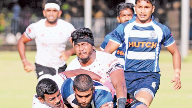 CH defenders (white jersey) tackling a Navy attacker. Picture by Wasitha Patabendige