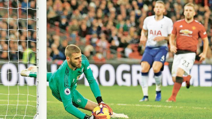 Unbeatable: Manchester United goalkeeper David De Gea was in superb form against Tottenham at Wembley. AFP