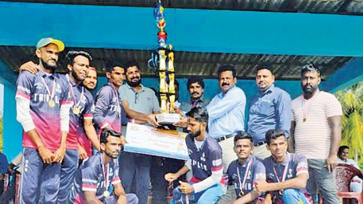 The skipper of Champions Akkaraipattu Triple –B Cricket Team receiving the trophy. Picture by: I.L.M.RIZAN, Addalaichenai Central Corr