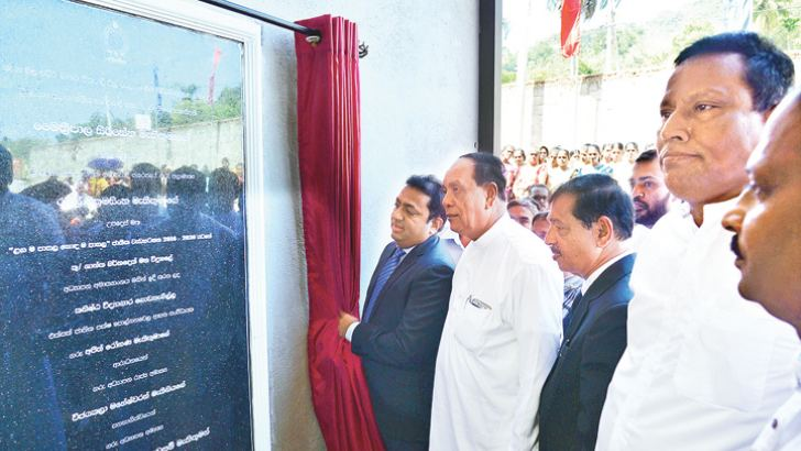 Education Minister Akila Viraj Kariyawasam opens the new laboratory.