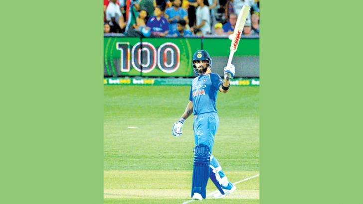 Indian captain Virat Kohli who scored a century acknowledges the cheers of the crowd during the second one-day international match between Australia and India at the Adelaide Oval on January 15,