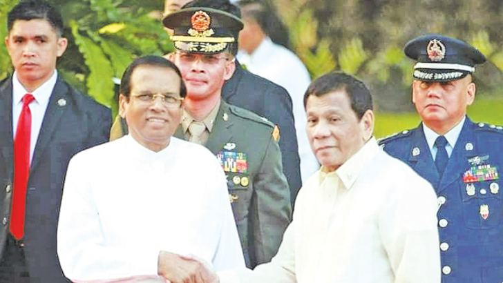 President Maithripala Sirisena who is in the Philippines on a four-day State visit welcomed by Philippines President Rodrigo Duterte at Malacanang Palace on Wednesday.   Picture by Sudath Silva, President's Media Division