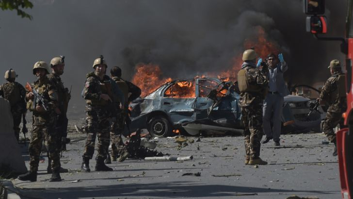Afghan Security Forces personnel at the site of a car bomb attack in Kabul.