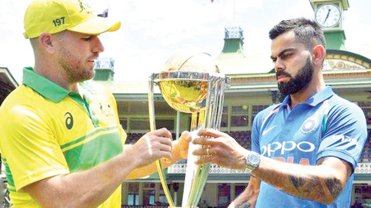 Australia captain Aaron Finch and India counterpart Virat Kohli with the World Cup trophy.
