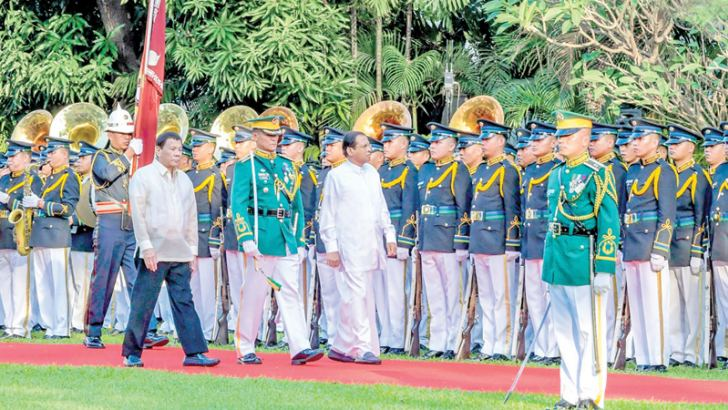 President Maithripala Sirisena inspecting the Guard of Honour with Philippines President Rodrigo Duterte at the Malacanang Palace in Manila.