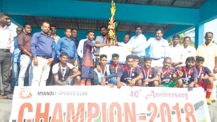 The  champion Minnoly Sports Club 'A' Team, Vinayagapura receiving the Thangarasa Sothimalar Memorial Trophy