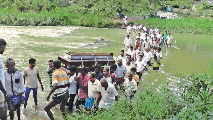 A funeral procession crossing the Oya.