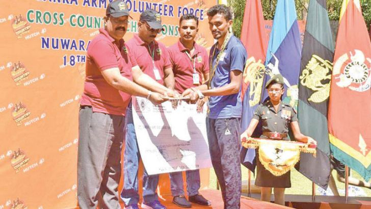 The winner of the Cross Country Marathon, Kasun Tharanga, receiving the medal, certificate and the cash award from Brigadier P.A. Kaluarachchi of the Army Volunteer Force Headquarters.