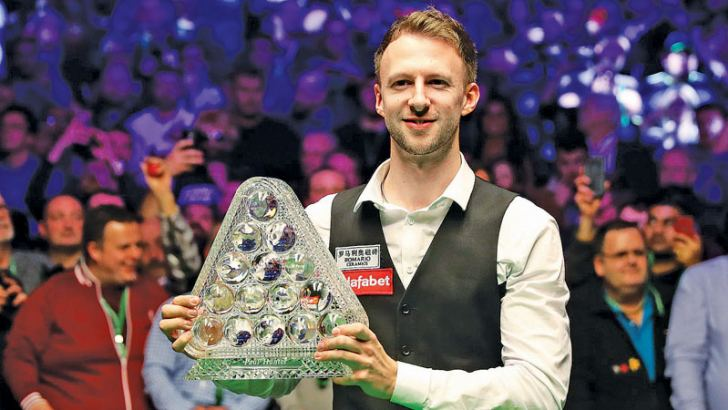 Judd Trump posing with the Masters trophy after beating Ronnie O'Sullivan 10-4.