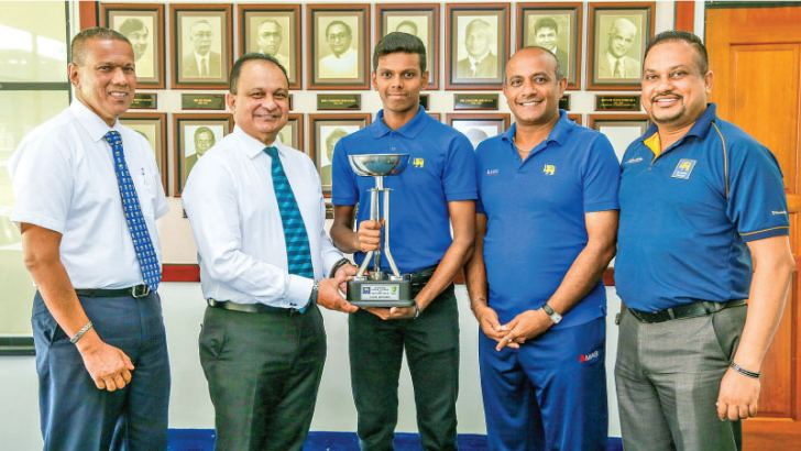 Sri Lanka under 19 captain Nipun Dananjaya handing over the under 19 trophy to SLC CEO Ashley de Silva. Chandima Mapatuna, Head of International Cricket, SLC, Coach - Hashan Tillakaratne and Team Manager - Nalinda Ilangakoon are also present.