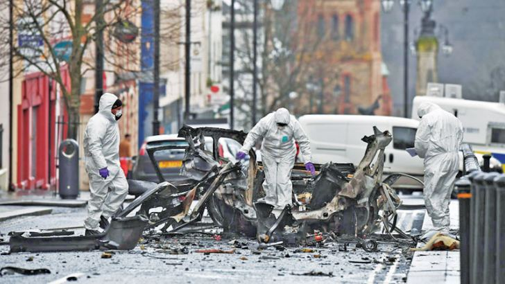 Forensic officers at the scene of a suspected car bomb in Londonderry, Northern Ireland.