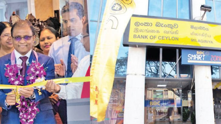 The BOC's CEO and General Manager Senarath Bandara opening  MiIlagiriya Branch. The Deputy General Manager Retail Banking Range1 and Range 2 D.M.L.B. Dassanayake and Deputy General Manager Support Services W.I. Hettihewa looks on.