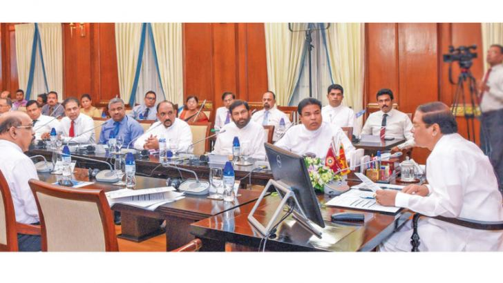 President Maithripala Sirisena speaks to officials at the meeting to curb the Sena menace. Picture courtesy President's Media Division