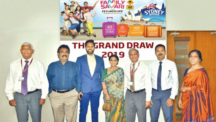 Ceylinco Life's Family Savari Ambassadors with senior management of the company and representatives of the Revenue Department of the Western Provincial Council at the grand draw.