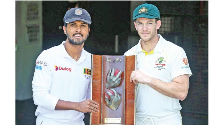 Sri Lanka captain Dinesh Chandimal and Australian captain Tim Paine with the Warne-Murali trophy for which the Test series is being played. Sri Lanka are the current holders of the trophy.