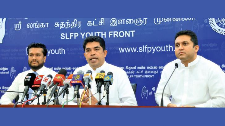 SLFP National Youth Front (NYF) Chairman Shantha Bandara (centre) and Eric Weerawardena (right) at the media conference yesterday. Picture by Nirosh Batepola