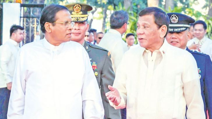 President Maithripala Sirisena who was on a State visit to the Philippines recently with Philippines President Rodrigo Duterte during a welcome ceremony at the Malacanang Palace in Manila. Picture by Sudath Silva