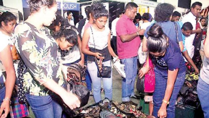 Some visitors at the 11th Footwear & Leather Fair which ended at the BMICH. Picture by Chaminda Niroshana