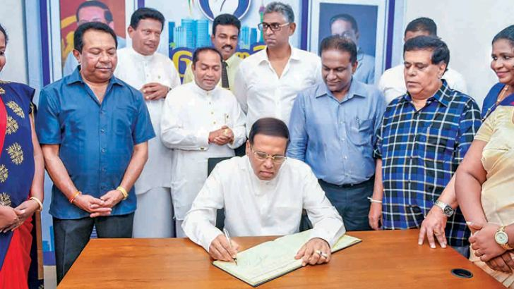 President Maithripala Sirisena opens the new SLFP office. Pictures by President's Media Division