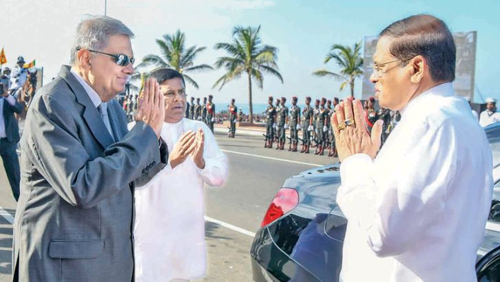 President Maithripala Sirisena is received by Prime Minister Ranil Wickremesinghe on his arrival for the 71st National Independence Day celebrations in Colombo yesterday. Pictures by Sudath Silva