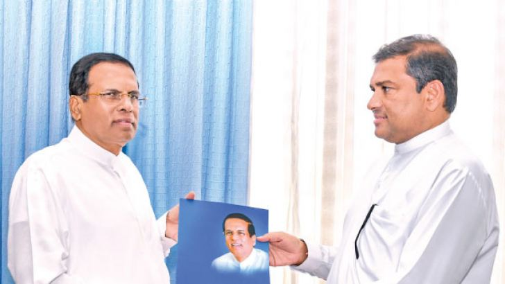 Former Minister Dayashritha Thissera has been appointed SLFP Puttalam district leader.  Thissera received  his   appointment letter from  the President  at the Office of the President at the   Parliamentary Complex. Pictures by Chandana Perera - President's Media Unit