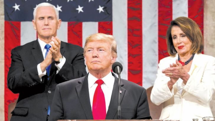 US President Donald Trump delivers the State of the Union address, alongside Vice President Mike Pence and Speaker of the House Nancy Pelosi, at the US Capitol in Washington, DC on Tuesday.