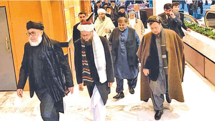 Taliban and Afghan representatives arriving for the peace talks.