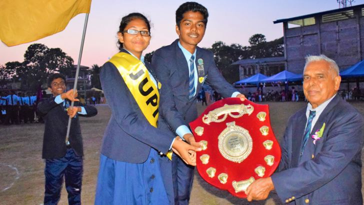 The Winning Jupiter House Captains (Boys) Saveen Disanayake and (Girls) Kretheesha Perumal receiving the Overall Championship Shield from the Principal of the College Daniel Edirisinghe at the event. (Pictures by Herbert Perera)