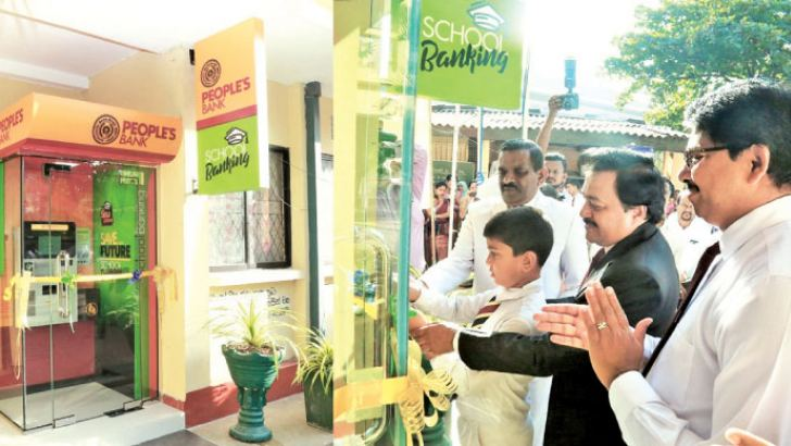Officials of People's Bank, students and staff of St. Sylvester's College Kandy opening the new unit.
