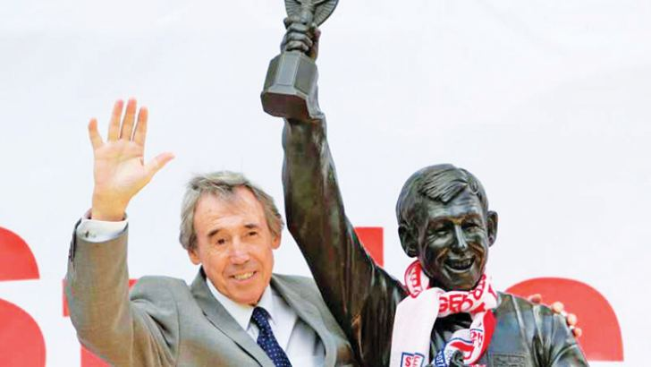In this July 12, 2008 file photo former England soccer goalkeeper Gordon Banks stands next to the new Gordon Banks statue at the Britannia Stadium in Stoke.