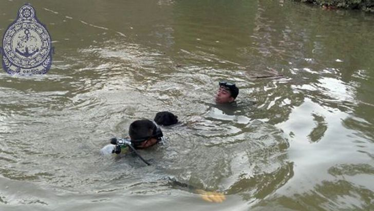 Navy divers recovering the body.
