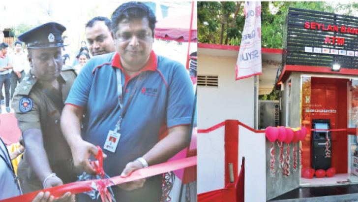 Area Manager of Seylan Bank,  Mutateesa, opening the Trincomalee off-site ATM, flanked by Rev. Dr. B. Paul Robinson (Rector St. Mary's Cathedral), Rev. Fr. Madurangan Croos (Administrator Devine Mercy Shrine), I.P. B A Premalal (OIC – Uppuveli Police Station), R.M.M Foumy (Branch Manager –Trincomalee)
