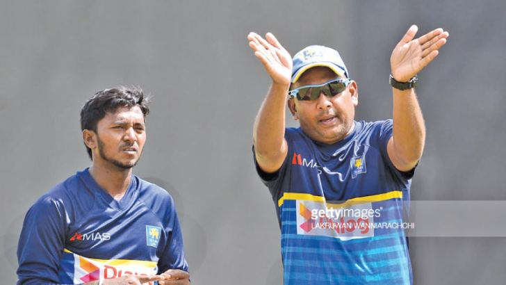 Akila Dananjaya working on his bowling action with spin bowling coach Piyal Wijetunge.