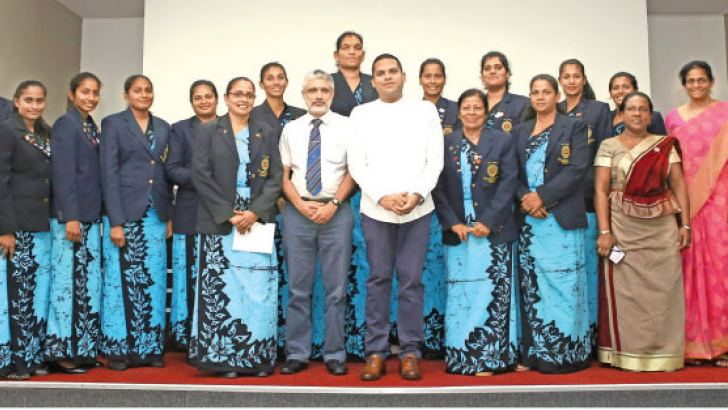 Sports Minister Harin Fernando with Netball team and their officials