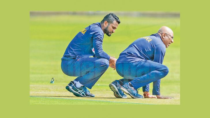 Sri Lanka captain Dimuth Karunaratne and coach Chandika Hathurusingha examine the pitch at Port Elizabeth venue of the second Test against South Africa on Thursday.