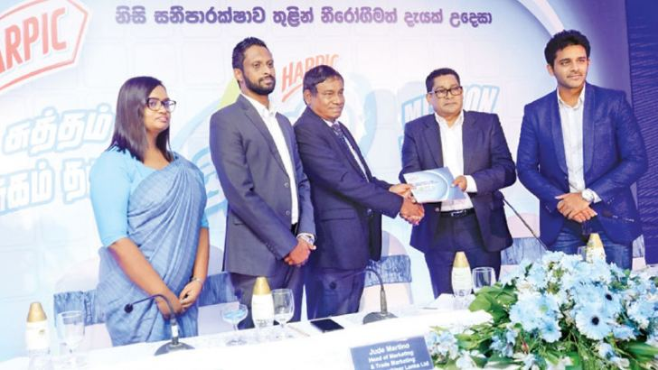 Harpic – Reckitt Benckiser Lanka Management presenting the Harpic Mission Wellbeing mission statement to Wimal Gunaratne, Additional Provincial Director of Education Western province.