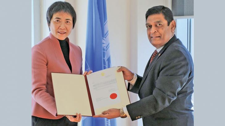 High Commissioner M.A.K. Girihagama, presenting his appointment letter  to ICAO Secretary General Fang Liu.