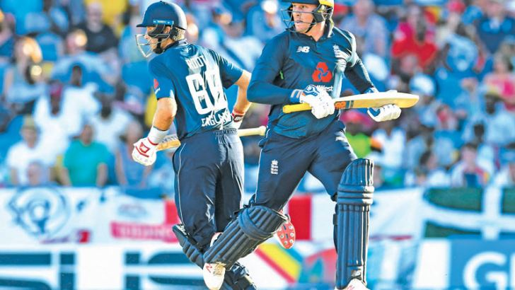 Jason Roy (R) and Joe Root (L) of England during their century partnership in the 1st ODI against West Indies at Kensington Oval, Bridgetown, Barbados, on Wednesday.