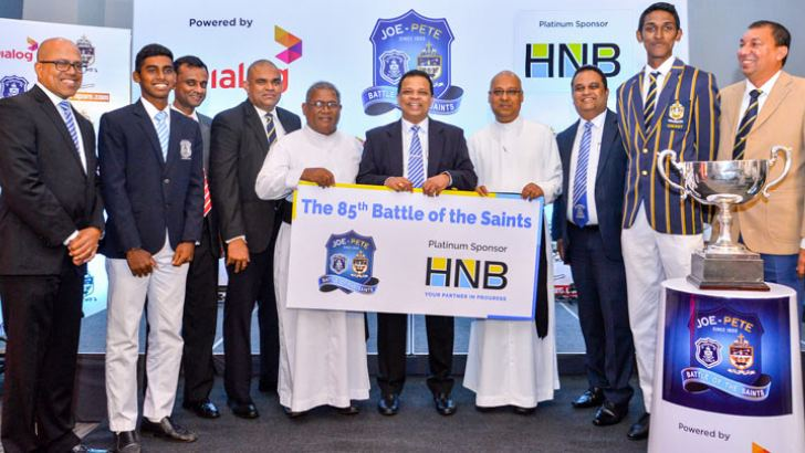 Jonathan Alles, MD/CEO of HNB, flanked by the Rectors of St. Joseph's and St. Peter's Colleges, the Captains of the Josephian and Peterite cricket teams and organising committee plus senior management of HNB.