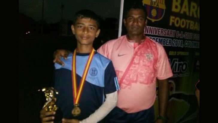 Nimsath Warnakulasuriya with his coach Danesh Kumar.