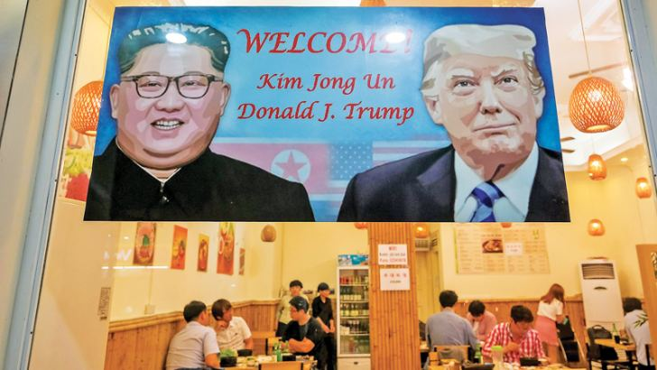 A sign at a Korean restaurant in Hanoi welcomes US President Trump and North Korean leader Kim Jong Un, who are scheduled to meet on February 27-28 in the Vietnamese capital.