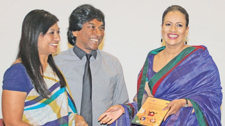 Presenting the first copy of the book and DVD to Sangeetha Weeraratne