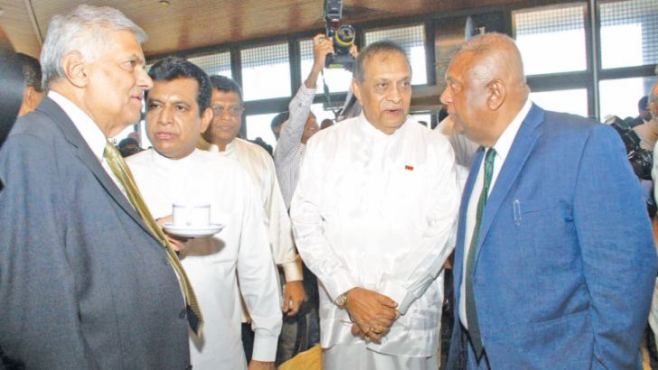 Parliamentarians, diplomats, business leaders and experts from various fields were among the invitees at the traditional tea party held at the Parliament complex yesterday after the Budget speech. Picture shows Prime Minister Ranil Wickremesinghe with Speaker Karu Jayasuriya, Ministers Mangala Samaraweera and Ashok Abeysinghe.