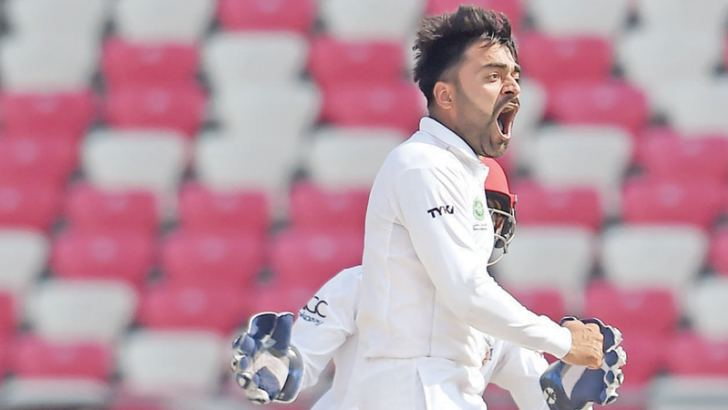 Rashid Khan celebrates after dismissing Ireland's George Dockrell during the third day of the inaugural Test match at the Rajiv Gandhi International Cricket Stadium, Dehradun on Sunday.- AFP
