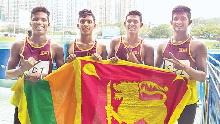 The Sri Lanka boys relay team that won a silver in the medley relay. Navishka Sandeesh who anchored the team to win and also won a silver in the 400m is on left.