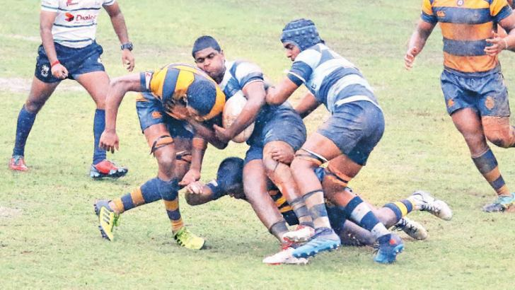 Royal defenders tackling a Wesley attacker (ball in hand). Picture by Saman Sri Wedage