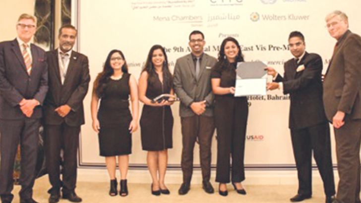 Ambassador Mendis handing over the certificate/award to the Law School of University of Colombo, the overall champions of the 9th Willem C. Vis International Commercial Arbitration Moot Award Ceremony. Prof. Ronald Brand (Right) and Chief Operating Officer of Bahrain Chamber for Dispute Resolution (BCDR), Dr. Ahmed Husain (Second from Left) are also on the stage at the Award Ceremony